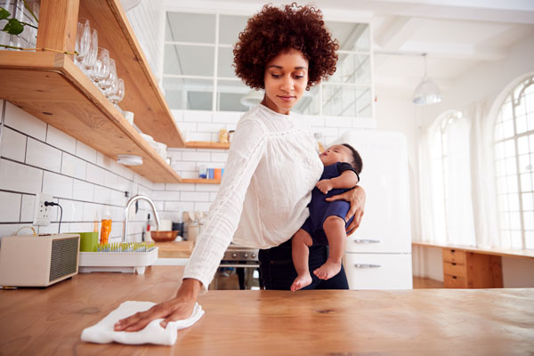 Woman and child safely cleaning